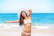Woman on beach enjoying sun happy on travel