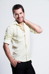 Portrait of happy man in yellow shirt.