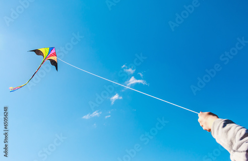 kite flying in a beautiful sky clouds - 65056248