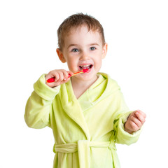 kid brushing teeth isolated on white