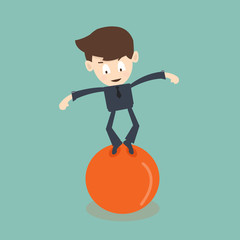 businessman standing in balance on the ball