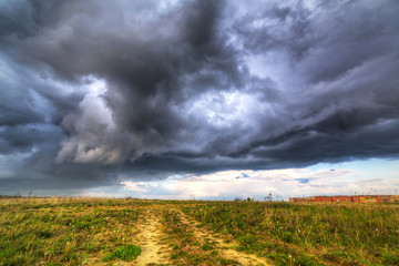 Summer storm over the meadow in Poland