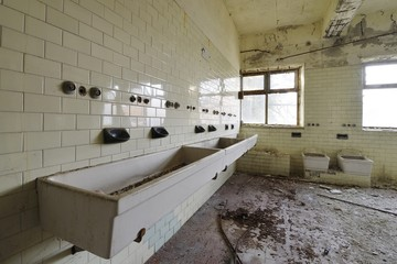 Old abandoned bath with windows