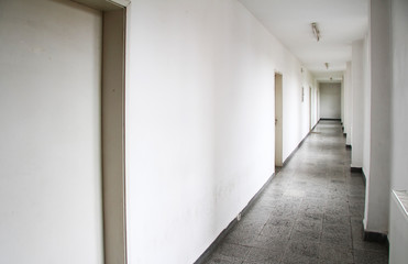 A long hallway in an old high school