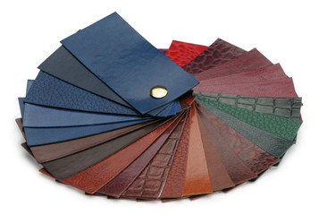 Fan of samples of leather isolated on a white background