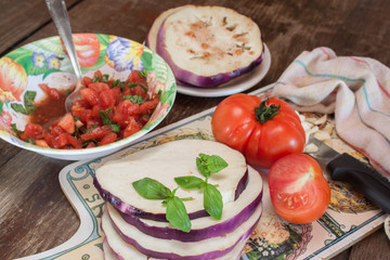 Cooking eggpland with tomatoes