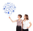 Happy ladies holding social icon balloon