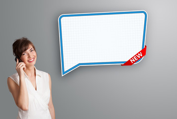 young woman standing next to a modern speech bubble copy space a