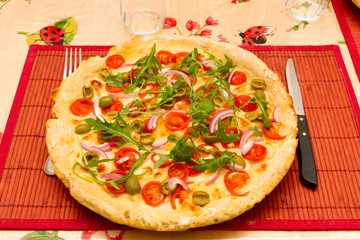 Pizza capricciosa on the table ready to eat