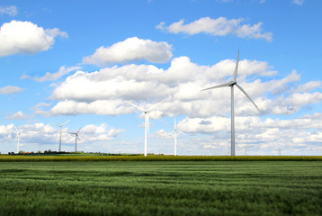 Wind turbines and cloudy blue sky