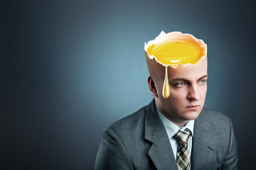 Businessman with  yellow egg istead of head