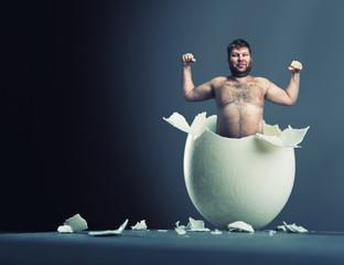 Egg with man inside isolated on gray background