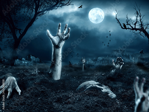 Zombie hand coming out of his grave - 65068858