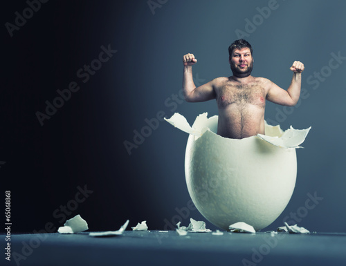 Egg with man inside isolated on gray background - 65068868
