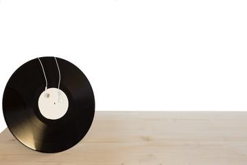 headphones with vinyl on wooden table