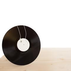 vinyl with headphones on wooden table
