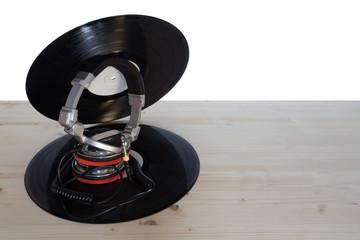 two vinyl with dj headphones