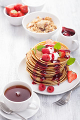 pancakes with berry and jam for breakfast
