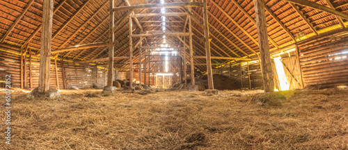 Panorama interior of old farm barn with straw - 65072852