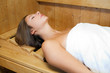 Beautiful woman in a sauna