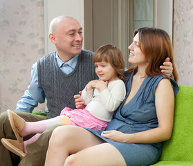 Happy parents with two-year child