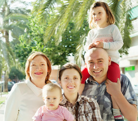Outdoor portrait of happy multigeneration family