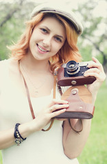 Retro girl photographer
