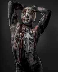 man with blood and blindfolded concept of prison, without freedo