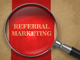 Referral Marketing Concept Through Magnifying Glass.
