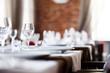 Leinwanddruck Bild - tables set for meal