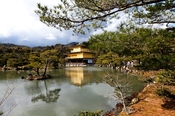 famous golden pavilion at Kinkakuji temple with blue sky, Kyoto,