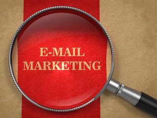 E-mail Marketing Concept Through Magnifying Glass.