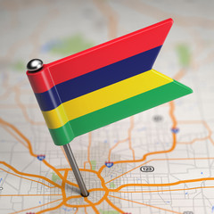 Mauritius Small Flag on a Map Background.