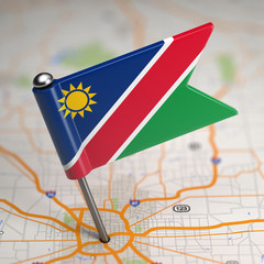 Namibia Small Flag on a Map Background.