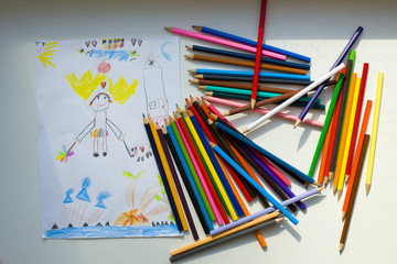 Funny drawing of the five-year-old child color pencils