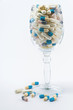 Pills in wine glass