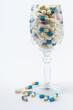 Pills in wine glass