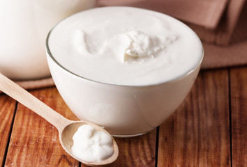 sour cream, yogurt on wooden background
