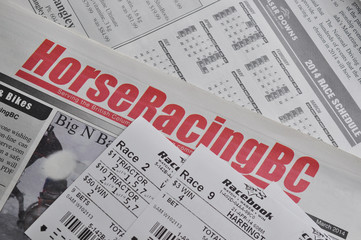 Horse racing newspaper and racing tickets background