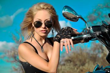 Stylized photo of young beautiful woman and bike