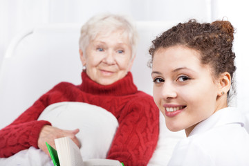 Female caregiver reading book