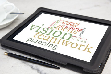 tablet with vision teamwork word cloud