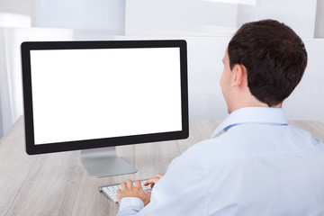 Businessman Using Desktop Pc At Desk