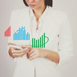 Businesswoman checking charts on smart phone