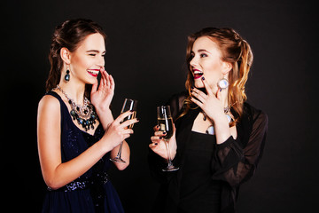 Two beautiful women in  black cocktail dresses