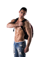 Shirtless muscular young man with rucksack on his back