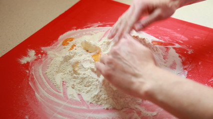 Baking cake. Female hands making dough.