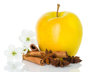 Ripe yellow apple with cinnamon sticks, anise star