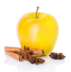Ripe yellow apple with cinnamon sticks and  anise star