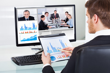 Businessman Video Conferencing With Colleagues